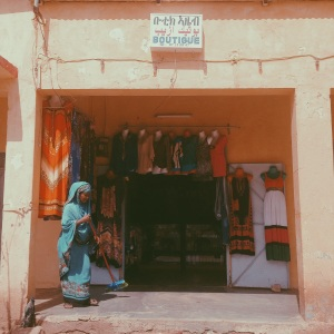 A boutique owner maintains her storefront between shopper drop ins on July 27, 2014 in Tessenei, Eritrea.