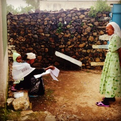 A worker inspects the pipes and then checks off a woman's name on a list of residents expecting to receive their water bill at the end of the month in Adi Quala, Eritrea on August 8, 2014.