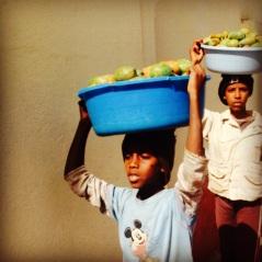 Beles buckets as top hats in Asmara, Eritrea. August 2014.