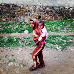 Two brothers brave the jagged roads of Adi Quala, a town that stretches two kilometers in Southern Eritrea. The town is home to fertile land and farmers who grow crops to supplement income. August 2014.