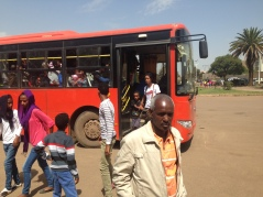 A city bus drops its passengers at the entrance of Expo, the annual family-festival showcasing cultural dances, art exhibits, innovation and a trolley ride in Asmara, Eritrea on August 24, 2014.