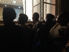 A crowd peers out the window of a Muslim wedding outside of Adulis Restaurant on a Sunday night in downtown Asmara, Eritrea on August 29, 2014.