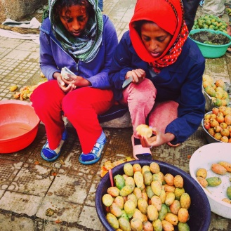 Two sisters sell the popular cactus pear fruit in the Medeber section of Asmara, Eritrea on September 6, 2014. Beles has a prickly exterior and mushy pink interior and heavily eaten during the rainy season. It costs 1 Nakfa and three are usually eaten in one setting.